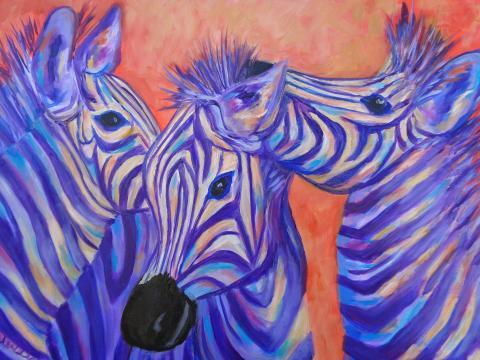 Three zebras in a playful noodAmigos
